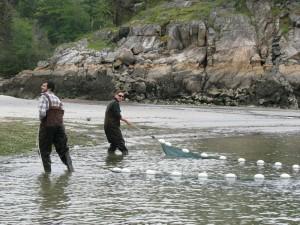 Two men fishing in creek