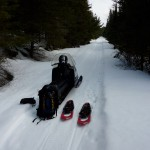Man seated on snowmobile